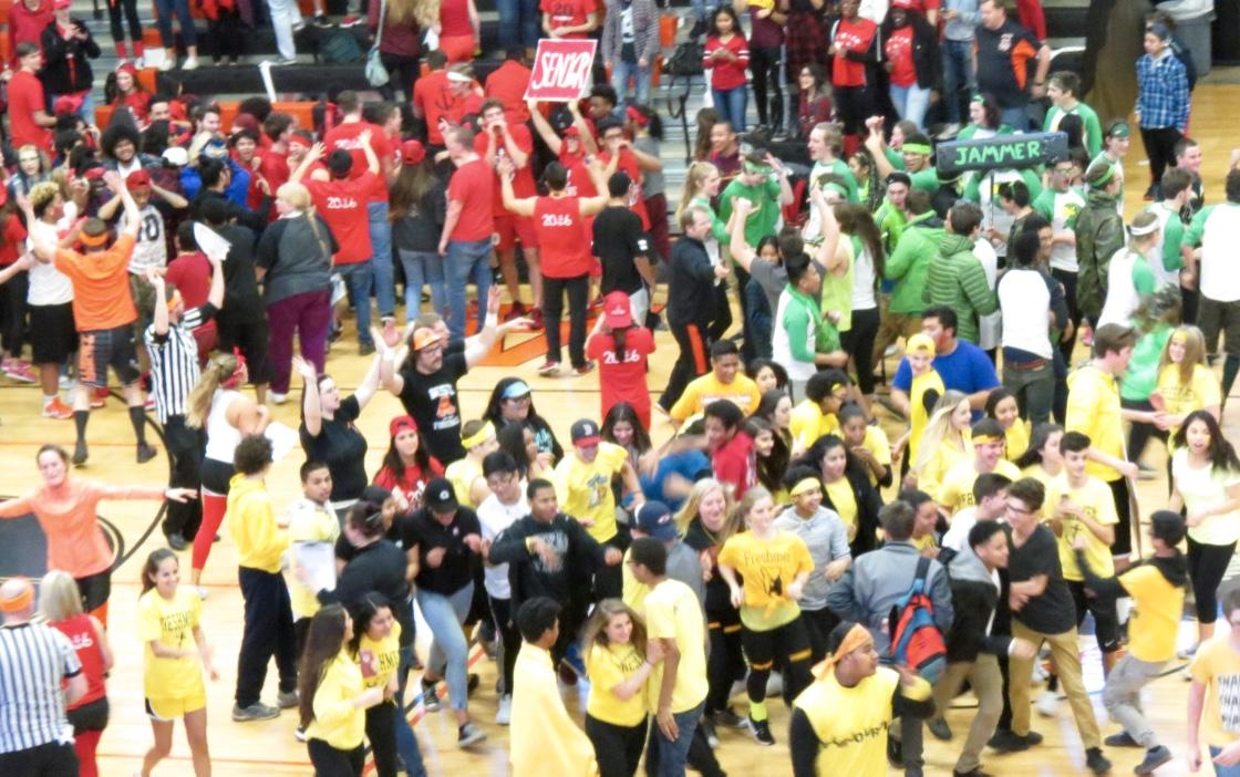 Students rushed the gym floor during the SWOOP Dance Off competition at the West High gym on Feb. 5.