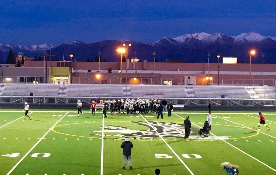 The varsity football team prepares for state, despite the chilly night.