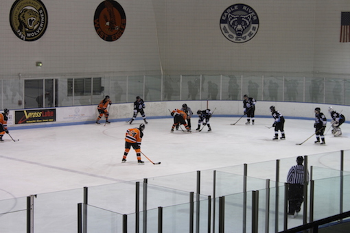 Here is the West High JV hockey team going against Chugiak High School, in the middle of the second quarter.