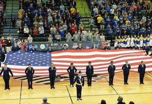 West High AFJROTC Cadets present the Big Flag at the 3rd Girls State Championship Game March 26th.