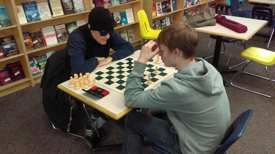 Silas Cook (right) and Charles Jacobs (left) play an endgame battle at the Title Wave Bookstore, on Oct. 14, Friday.