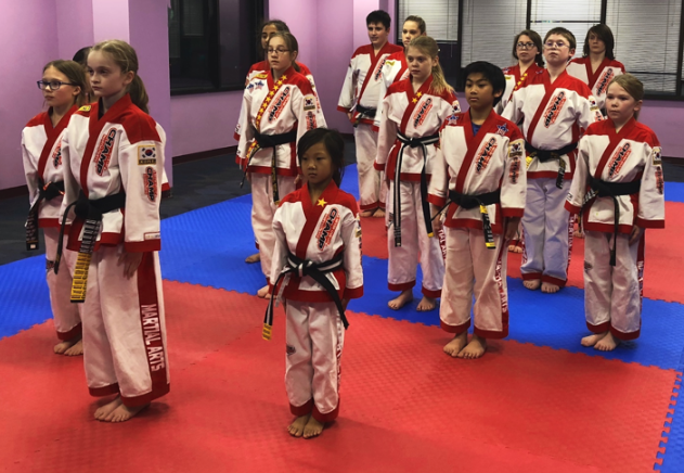 The junior masters club are getting ready to start the finally for the health kick festival while they are also listening for advice when they do their performance.