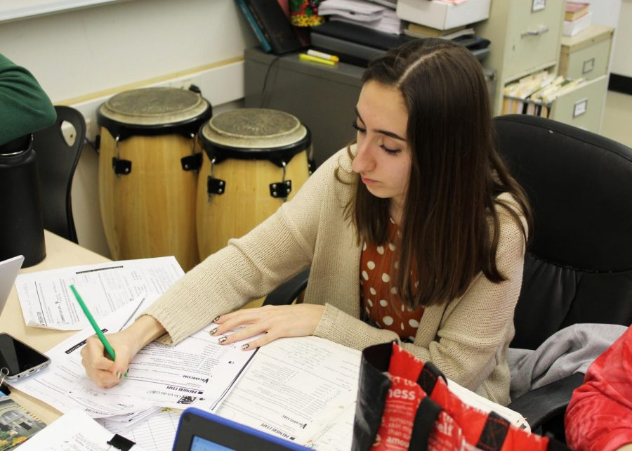 Lindiana dobrova (aide) grading assignments mr schumacher for his french class