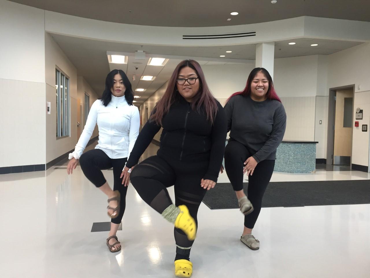 West seniors Shella Elgarico, Daniella Sudaria and Colleen DeLeon practice their moves for a TikTok.