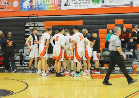 The Eagles team up and huddle together around Coach Muehlenkamp on a West timeout at West Anchorage High School on Tuesday January 21st, 2020.