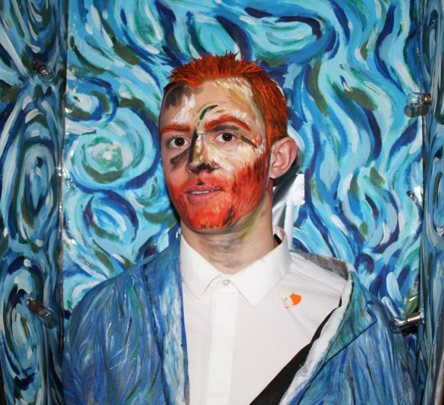 "Noah Goltz, a junior in the IB Art class, poses to show off his painting after the show.  He chose to recreate ""Self-Portrait"" by Vincent Van Gogh."